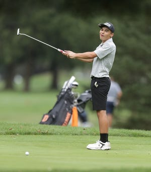 Hoover's Daniel Gambone reacts to just missing his putt on hole No. 6 at Tannenhauf Golf Course during Friday's Marlington Invitational.
