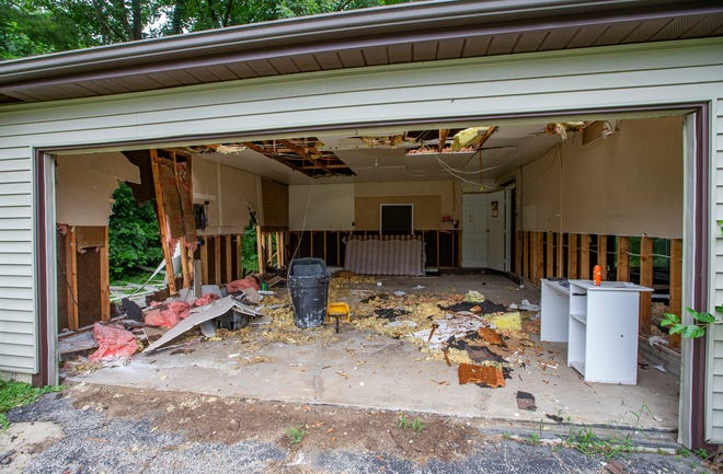 Flood-prone homes slated for removal on Opal Street, in the Jewel Woods neighborhood, on Friday in South Bend.