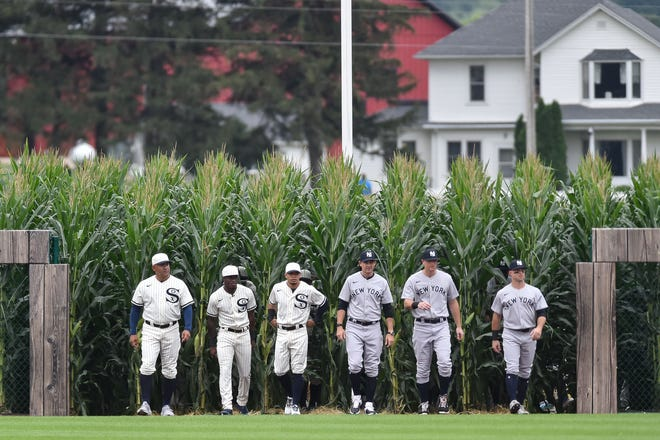 Aug 12, 2021; Dyersville, Iowa, USA; Players enter the Field of Dreams before a game between the Chicago White Sox and the New York Yankees. Mandatory Credit: Jeffrey Becker-USA TODAY Sports