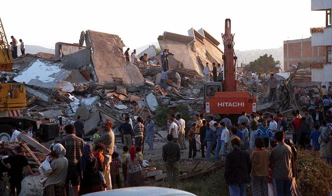 Rescue workers search for survivors in Kocaeli, Turkey, after a massive earthquake hit the nation on Aug. 17, 1999. Thousands were killed.