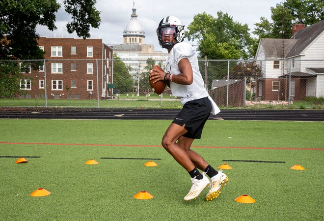 Springfield High School senior quarterback Rashad Rochelle goes through drills during practice at the New Street Athletic Facility on Aug. 13. [Justin L. Fowler/The State Journal-Register]
