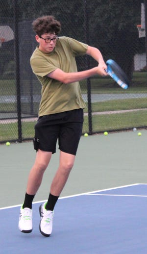 Adam Donmyer returns a shot during the Sturgis Hit-a-thon in July.