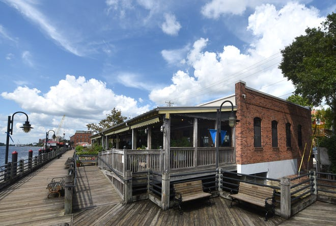The George on the Riverwalk is currently closed in Wilmington, N.C., Friday, Aug. 13, 2021. They have closed for a few weeks to give employees a break and to train and hire new people before the Labor Day holiday. The restaurant is one of many facing issues with finding employees.