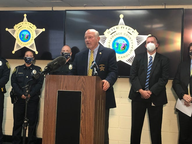 Sheriff Terry Johnson speaks at a press conference on Friday about a series of recent shootings in Alamance County.