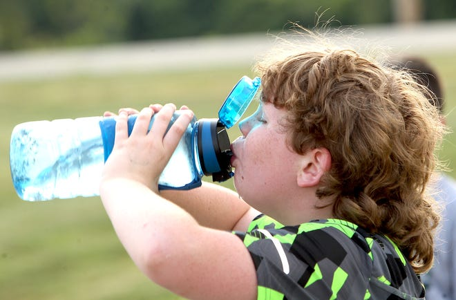 John Morris takes a water break during the Boys and Girls Club of Lawrence County 5th and 6th grade football practice at Parkview Field Thursday.