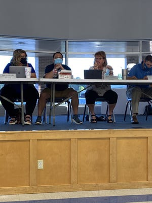 Paris School Board Secretary Beth Ullrich makes a motion to require masks for kindergarten through eighth-grade students. The motion passed 3-2.