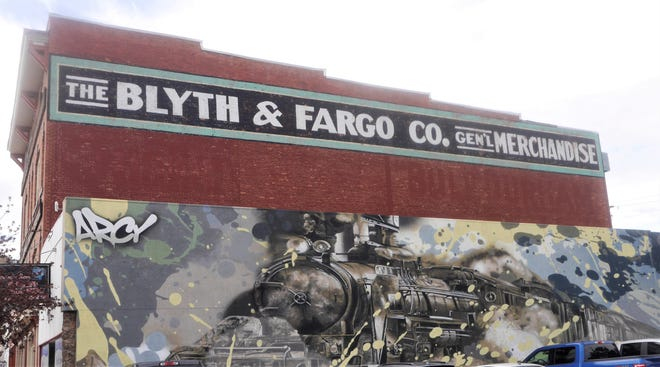 A mural depicts the railroading history of Evanston, Wyoming in the city's historic downtown.