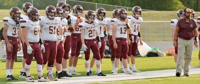 Head coach Brian Allmendinger (right) is pictured on the sidelines along with Milbank Area football players during the 2020 season.