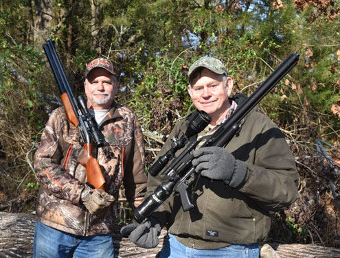 Luke Clayton (right) and his buddy Jeff Rice heading out on a hog hunt with their big bore air rifles chambered for .45 and .50 caliber.