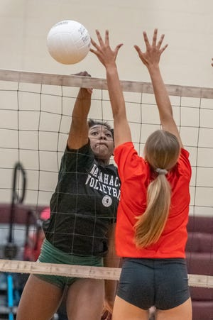 Waxahachie senior Jh'Kyah Head (4) goes on the attack during a preseason scrimmage last Friday at Red Oak. The Lady Indians opened the season with a four-set victory at Burleson Centennial on Tuesday.