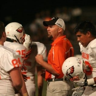 Avalon head football coach Malcolm Cole talks to his defense during a past game. The Eagles are coming off a second straght appearance in the playoffs.