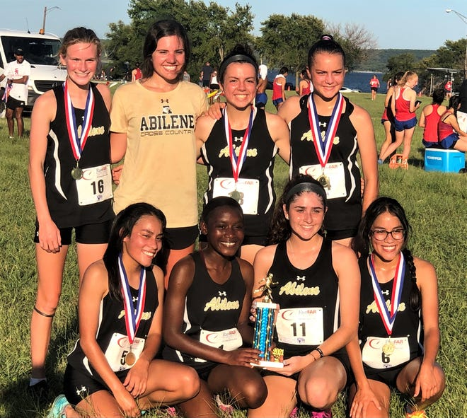 The Abilene High girls won the 2 Miles Texans Cross Country Meet on Thursday, Aug. 12, 2021 in Grand Prairie. Pictured, front left to right, is Elisabeth Estrada, Rebecca Albert, Kaylee Monroe and Elvira Estrada. On the back row is Zoe Vann, who finished third, Molly Bessent, and sisters Marin Murray and Mason Murray, who finished second and first in the season-opening meet.