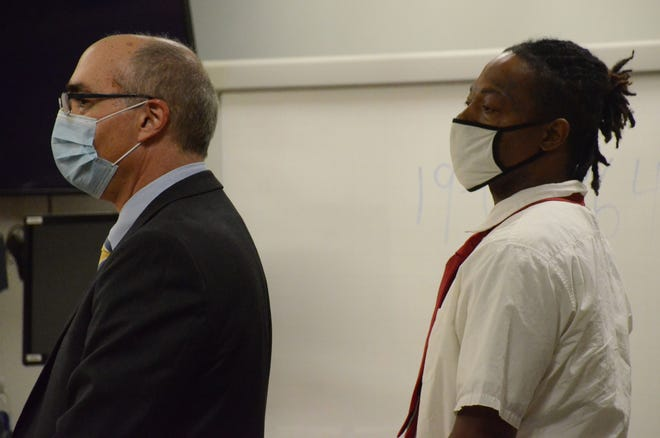Andre Yarbrough, right, and his attorney, David Makled, listen Friday to the jury announce their verdict.