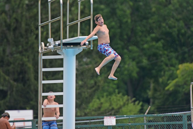 Nykkelis Zornes, 12, spins as he jumps off the diving board at Aumiller Park Pool last week. A busy season is coming to an end at the Aumiller Park Pool. Beginning today the pool will be closed weekdays. It will remain open 1-7 p.m. Saturdays and 1-6 p.m. Sundays, the city announced on its Facebook page.