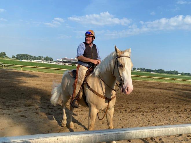 Larry Jones on his pony, also named Larry.