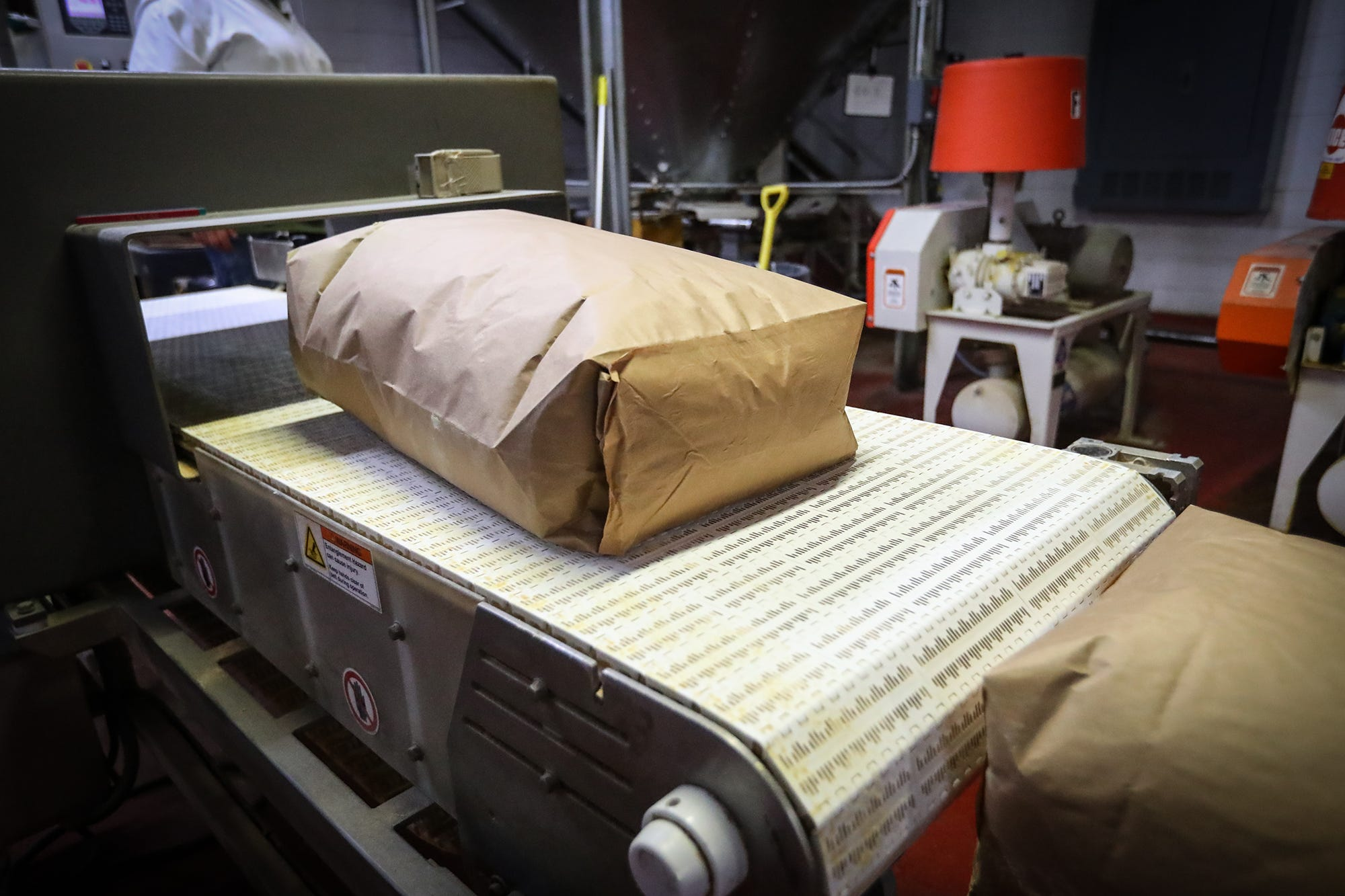 A 55 pound bag of mustard flour comes off a conveyor belt at Wisconsin Spice Inc. in Berlin. Mustard flour gets used in a wide range of products but Wisconsin Spice's core customers use the flour in dressings and sauces both for flavor and as a natural thickener.