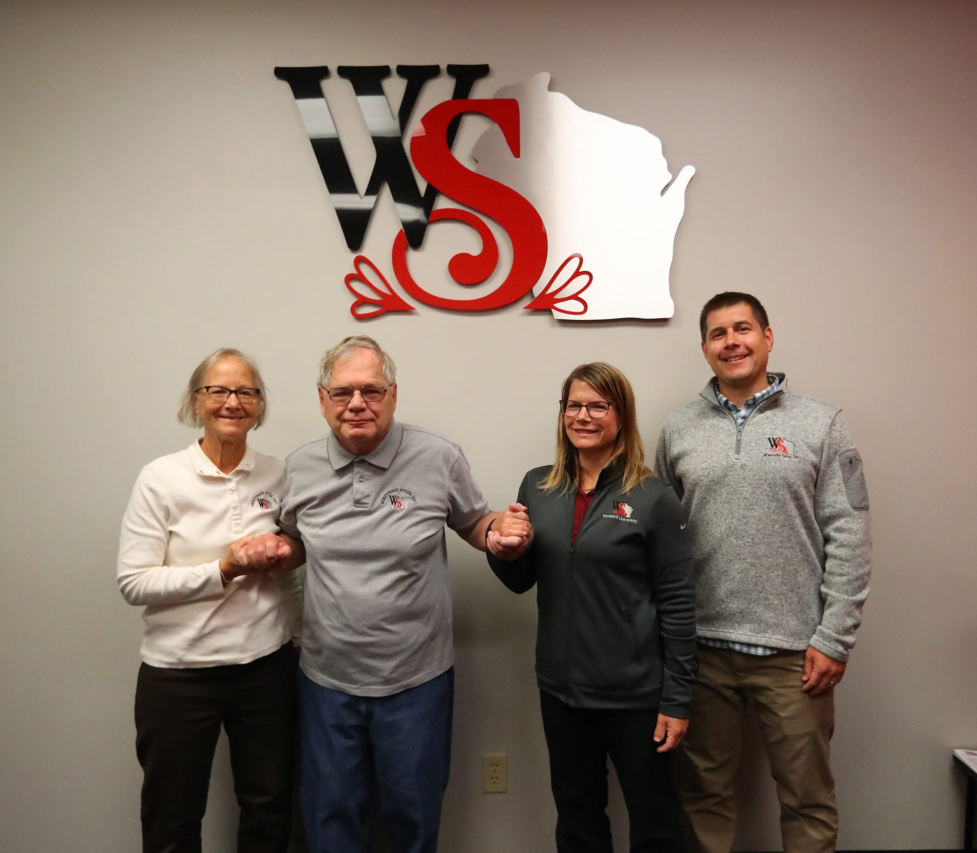 Beth Sass with husband Phillip Sass (Wisconsin Spice Inc. founder) and daughter Caroline Sass-Blustin (vice president) and son Allen Sass (president) at Wisconsin Spice Inc. in Berlin. The family-run company opened in 1973. It operated in a converted feed mill in downtown Berlin before out growing that space and moving to the Berlin Industrial Park.