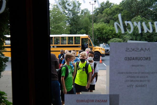 Kids begin to arrive at Community Baptist Church to take part in after school activities at the Henderson Unit of the Cliff Hagan Boys & Girls Club Wednesday afternoon, Aug. 11, 2021.