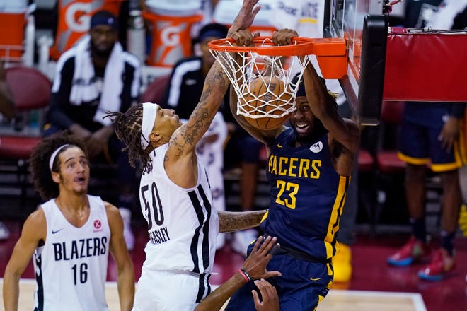 Indiana Pacers' Isaiah Jackson dunks against Portland Trail Blazers' Michael Beasley during the first half of an NBA summer league basketball game Thursday, Aug. 12, 2021, in Las Vegas. (AP Photo/John Locher)