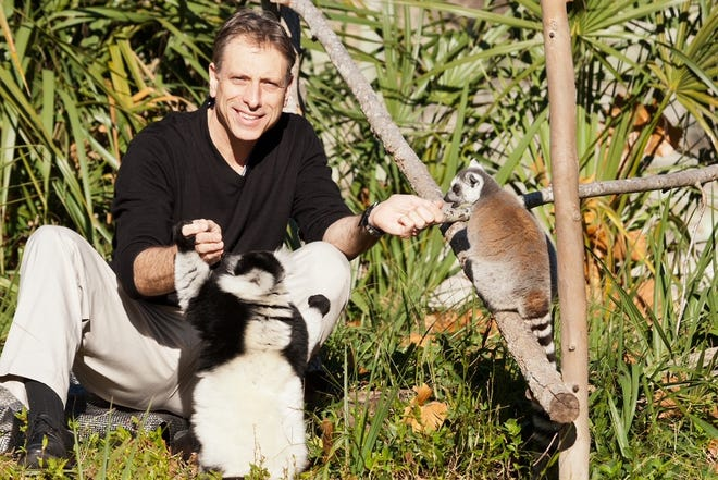 Daniel Maloney, the new director of the Louisville Zoo, with lemurs