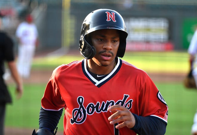 Former U of L and current Nashville Sounds outfielder Corey Ray returns to the dugout after scoring a run during a game against the Louisville Bats at Slugger Field, Thursday, Aug. 12, 2021 in Louisville Ky. Ray made his MLB debut earlier this year.