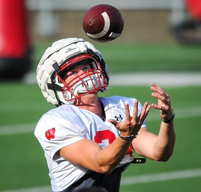 Wisconsin freshman safety Hunter Wohler makes a catch at practice on Friday at Camp Randall Stadium. Wohler was the state player of the year the last two seasons at Muskego High School.