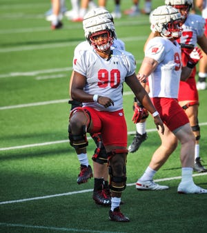 Wisconsin defensive end James Thompson Jr. (90) goes through a drill at practice Friday at Camp Randall Stadium. Thompson is back after missing the final five games of the 2020 season with an Achilles injury.