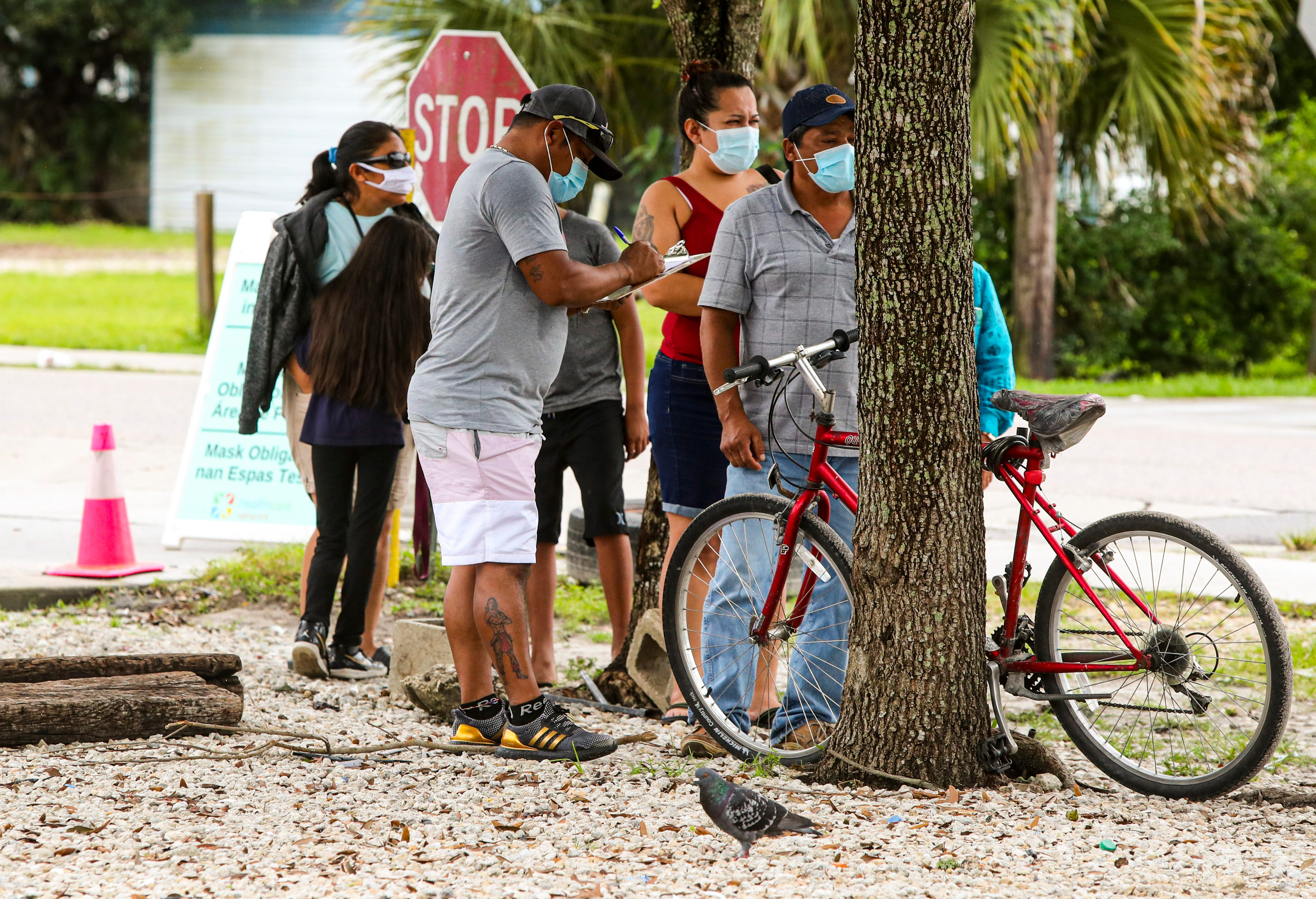 Healthcare Network hosts regular COVID-19 testing pop-up events in Immokalee, Florida. People lined up early for an event on Aug. 4, 2021.