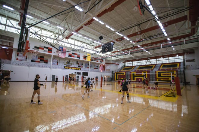 The varsity girls volleyball team practice at Centennial High School on Thursday, Aug. 12, 2021.