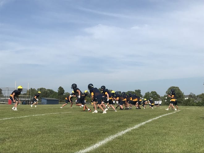 South Lyon football lines up for drills two weeks before its season opener against Walled Lake Western.