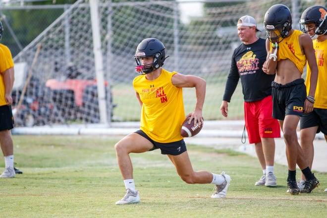 Quarterback Daniel Carter warms up before practice at Palm Desert High School in Palm Desert, Calif., on August 11, 2021.