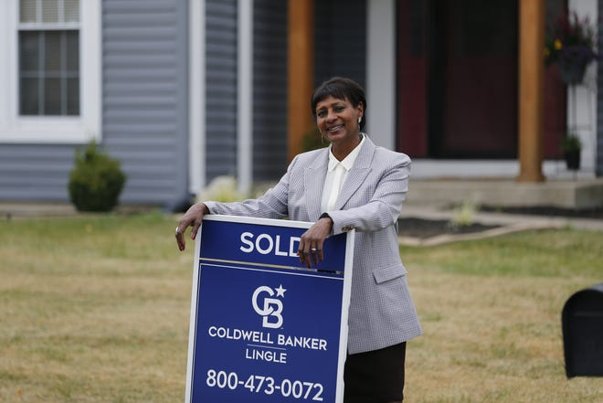 Real estate agent Donna Spears in front of a house she recently sold on Eagle Trace in Richmond, Indiana.