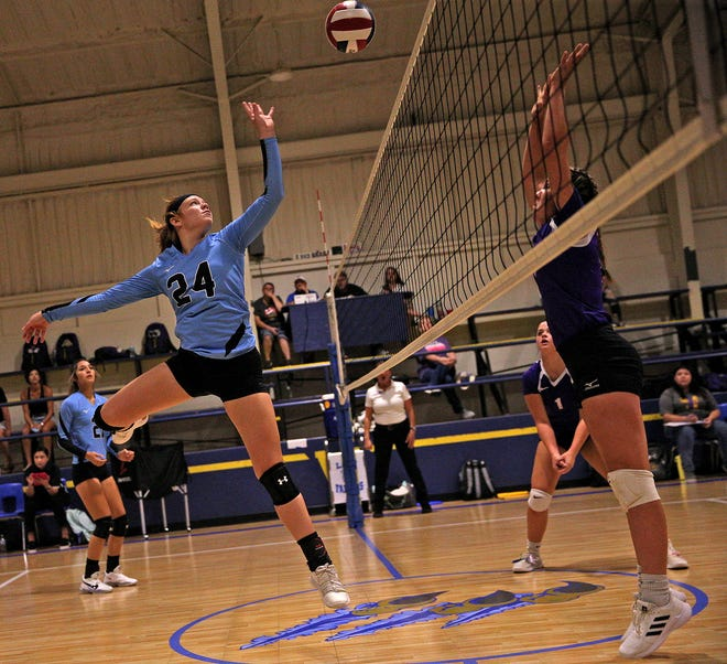 Madison Smith, left, taps the ball over the net for TLCA during a game against Early at the Falcon Fest Volleyball Tournament in Veribest on Friday, Aug. 13, 2021.
