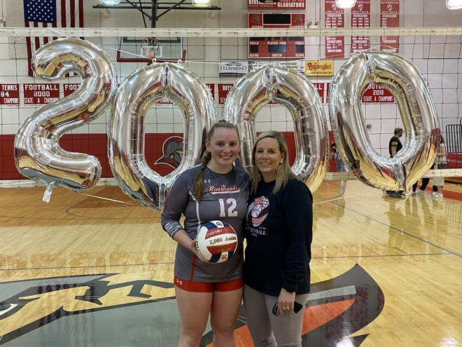 Dayton Moore and her mom Amy Moore pose for a photo the night of the state semifinals match against Middlesex on April 20. Dayton earned her 2,000 career assist and pushed the Riverheads into the state championship match.