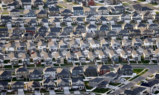 FILE - Rows of homes, are shown in suburban Salt Lake City, on April 13, 2019. The U.S. Census Bureau's release Thursday, Aug. 12, 2021, of detailed population and demographic changes in each state will kick off the once-a-decade redistricting process that plays a large role in determining which party controls state legislatures and the U.S. House. (AP Photo/Rick Bowmer, File)
