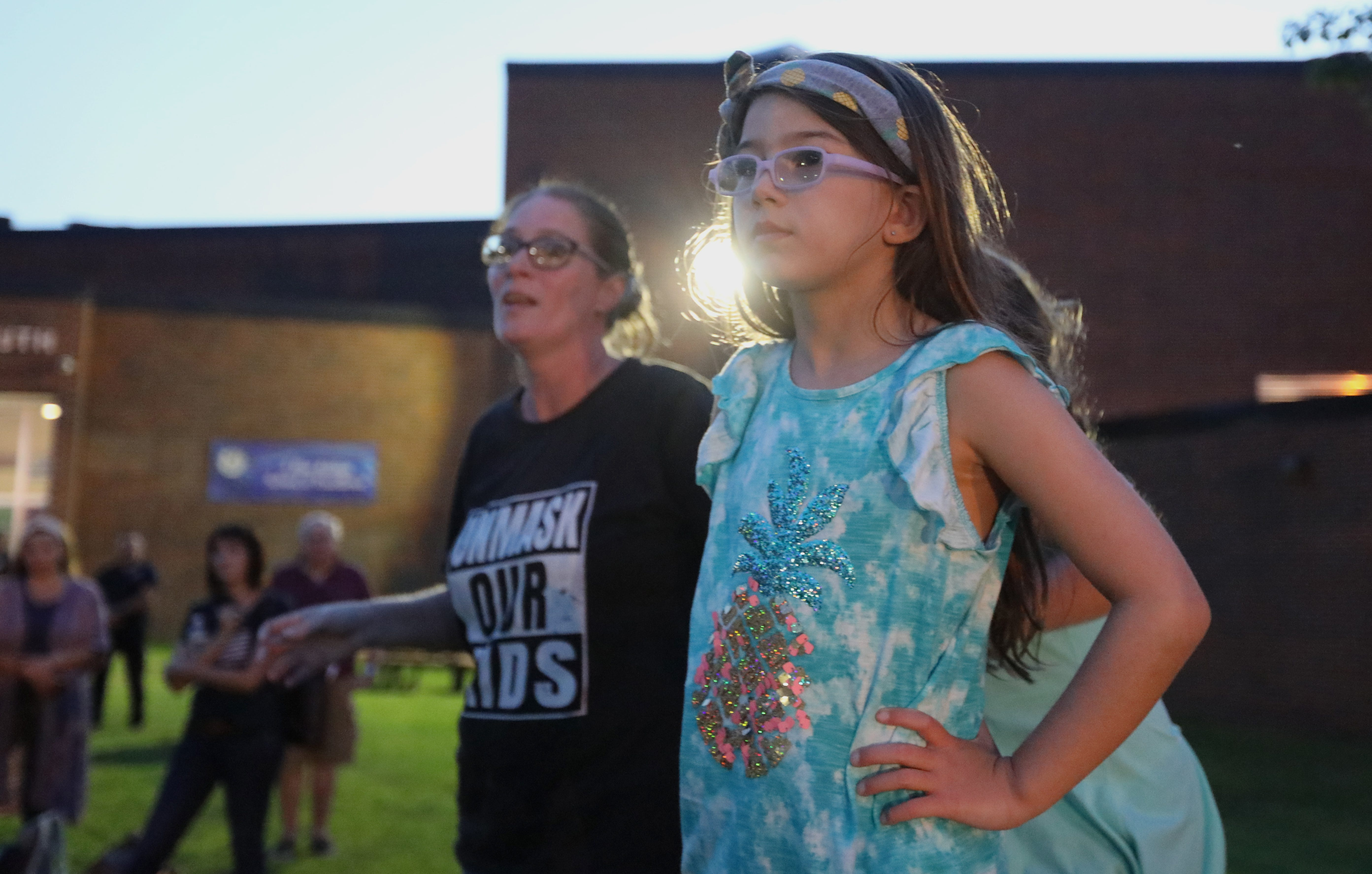 Karalyn Maggino, with her daughter, Madison, 8, speaks outside of Clarkstown South in West Nyack after a Clarkstown School Board meeting was adjourned early when many attendees refused to wear masks Aug. 12, 2021.