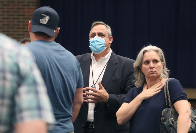 John Lanave, Clarkstown Schools Assistant Supervisor of Business, asks unmasked attendees to leave during a Clarkstown School Board meeting at Clarkstown South in West Nyack Aug. 12, 2021.