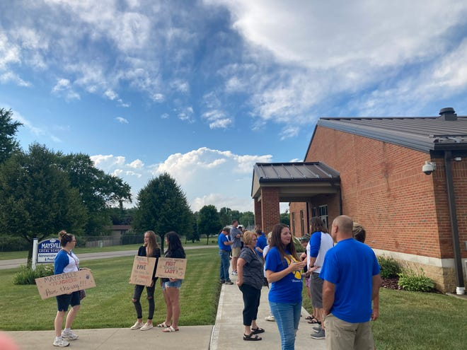 Maysville Education Association and supporting community members gathered outside of the district office in Newton Township for a July 1, 2021 school board meeting. Teachers union contracts were approved Thursday after federal remediation when the board and MEA initially failed to reach an agreement, the union confirmed.