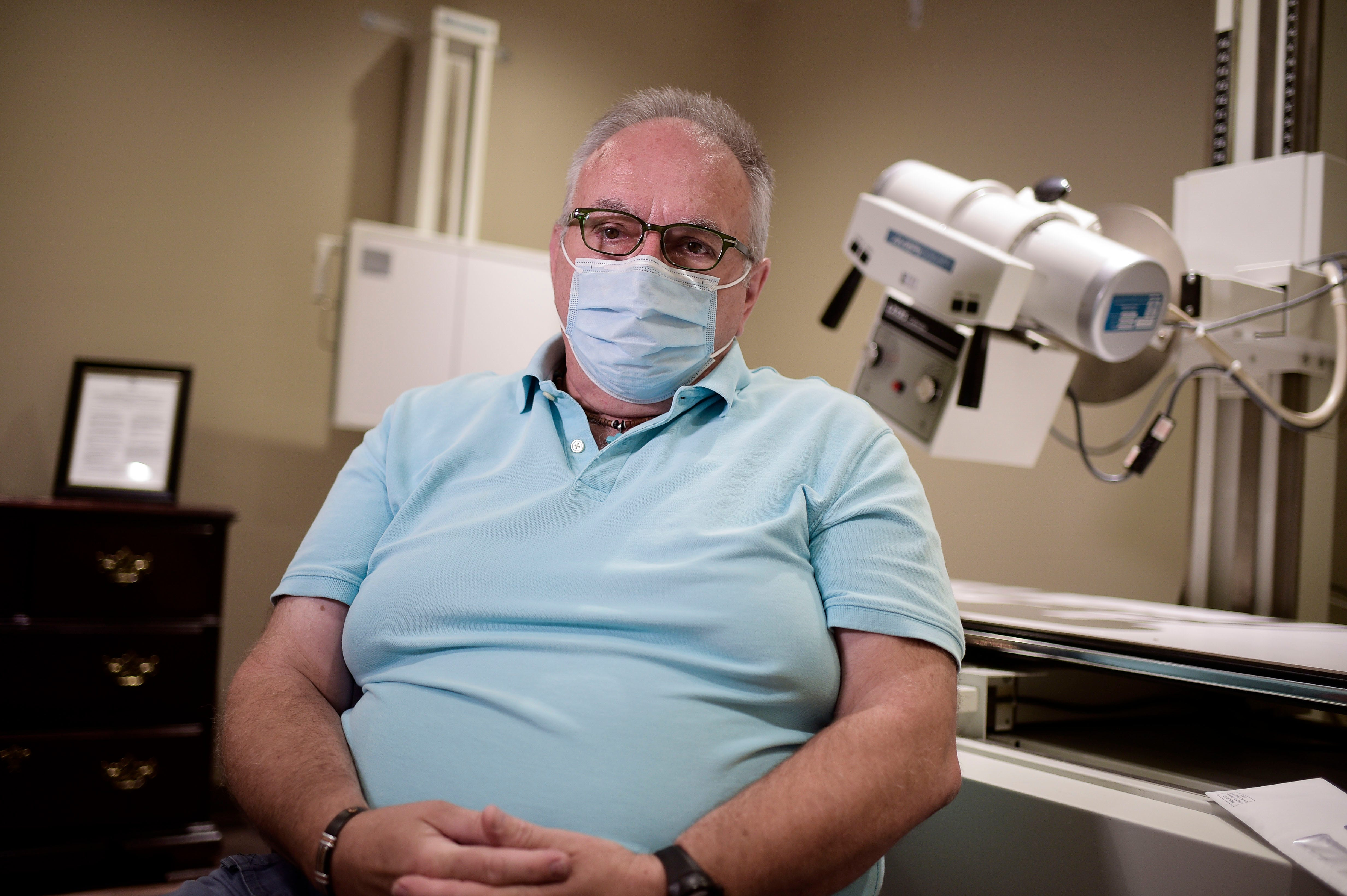 Steve Smith inside the X-ray room at the Smiddy Clinic in Wise, Virginia. Smith, a former police officer, has been experiencing long-haul symptoms after contracting COVID-19 late last year.