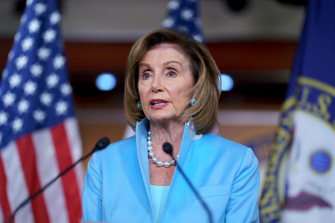 """In this Aug. 6, 2021, file photo, Speaker of the House Nancy Pelosi, D-Calif., meets with reporters at the Capitol in Washington. Moderate House Democrats say they'll sink a crucial fiscal blueprint outlining $3.5 trillion in social and environment spending unless a separate infrastructure bill is approved first. Nine of them have written Pelosi saying they """"will not consider voting"""" for the budget resolution unless the separate, $1 trillion infrastructure measure is first enacted into law."""
