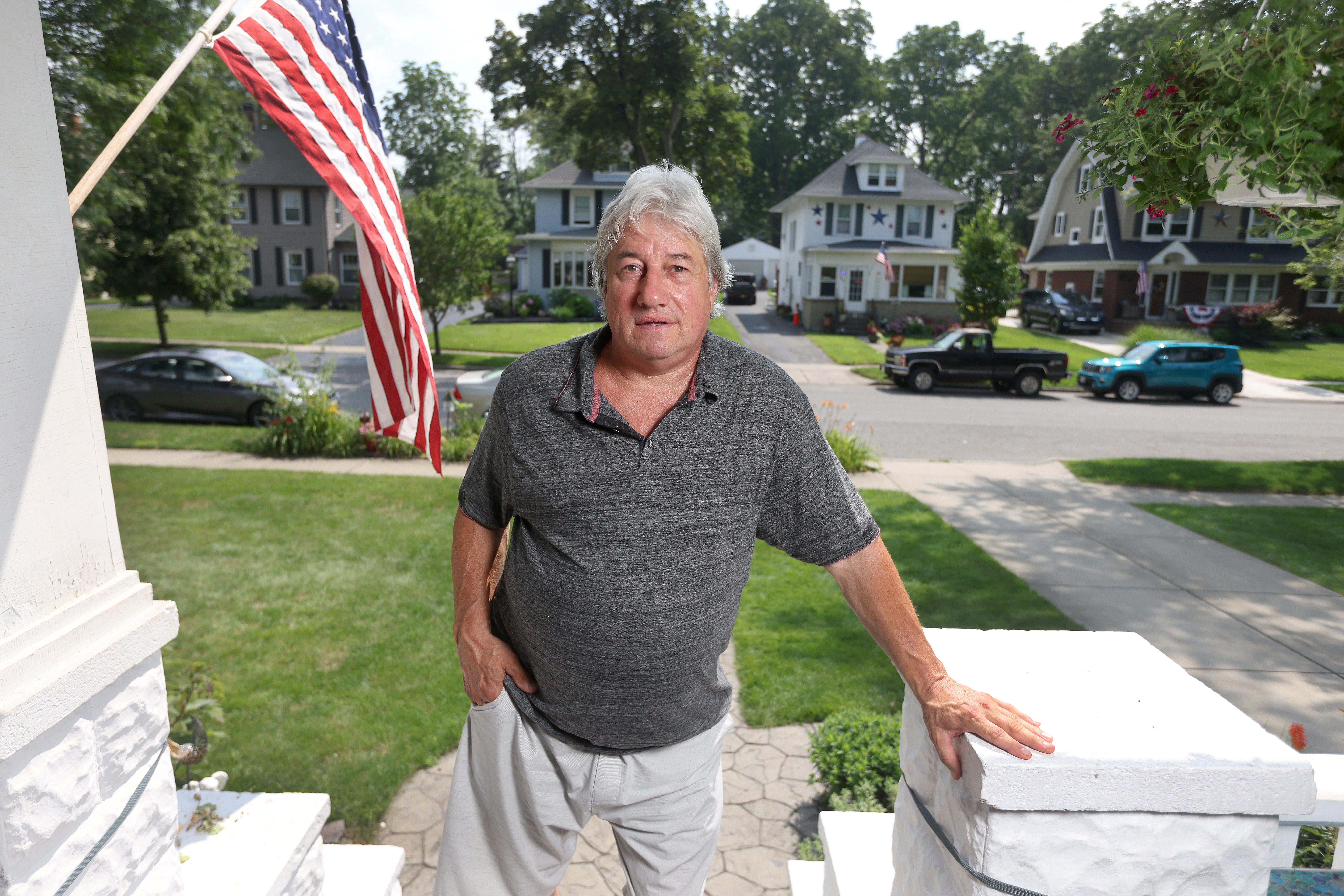 Ron Gaca of Lancaster, a Buffalo suburb, spends much of his time on the front porch. He wants to go back to work pouring concrete but his lingering Covid-19 ailments include fatigue and tremors in his right arm and hand.