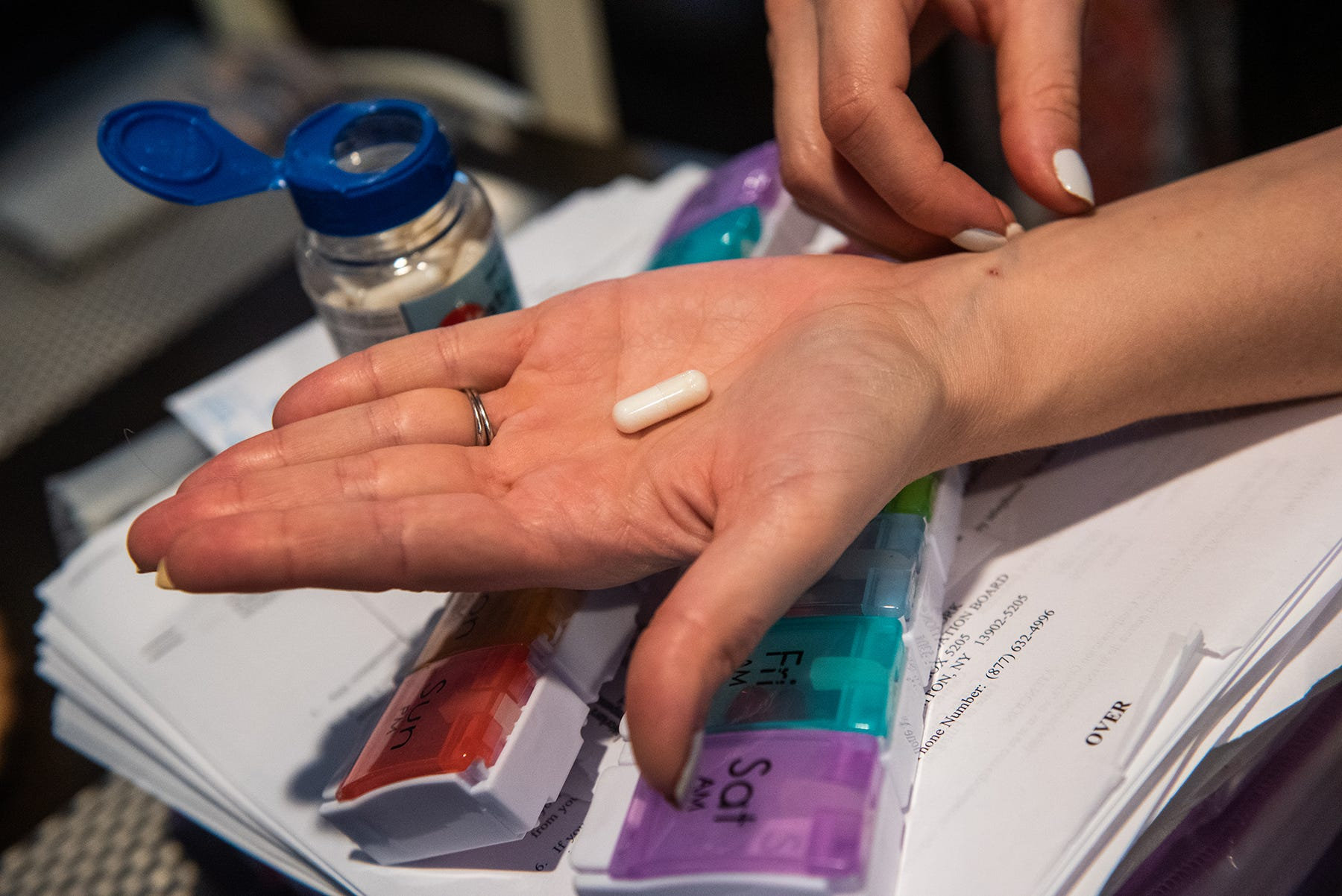 Caitlin Barber shows a salt pill at her home in Saugerties, NY on Wednesday, July 28, 2021. Barber caught COVID-19 while working at a nursing home in 2019, she has recently been diagnosed with POTS, and has to take up to 10,000mg of salt a day to manage her condition. Kelly Marsh/For the Times Herald-Record