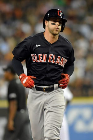Cleveland second baseman Ernie Clement rounds the bases after hitting a home run off Detroit Tigers relief pitcher Derek Holland in the seventh inning of Cleveland's 7-4 win Friday night in Detroit. [Jose Juarez/Associated Press]