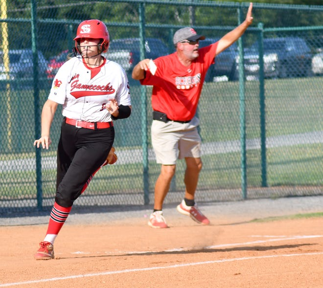 With Screven County Head Coach J.R. Doyle navigating Lady Gamecocks on the basepaths, senior Rhianna Boddiford rounds third to score another run against visiting Burke County on Aug. 10.