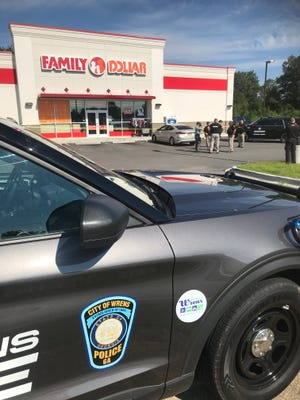 Officers from Wrens PD, alongside deputies from the Jefferson County Sheriff's Office and Richmond County Sheriff's Office, tape off the front of the Family Dollar Store while investigating the scene of a shooting that occurred there Saturday, Aug. 14.