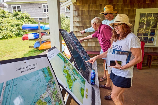"""The Pocasset Quality Water Quality Committee held its annual meeting in Pocasset on Saturday morning. Secretary, Deanna Kardoos, Treasurer, Francis """"Frank"""" Gasson, and Barney Jones, from Pocasset, discuss and observe the various changes in water flow in the area."""