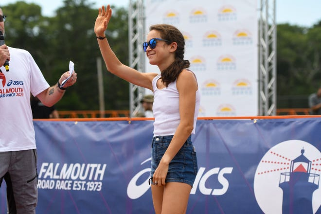 Olympic marathon bronze medalist Molly Seidel waves to fans before a Q&A at the Tommy Cochary High School Mile and Elite Mile on Saturday in Falmouth.