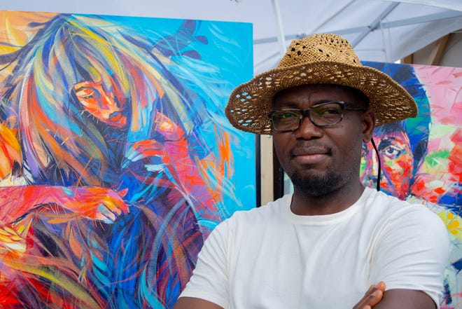 Said Oladejo-lawal, of Columbus, returned to the festival this year to display his one-of-a-kind artwork.