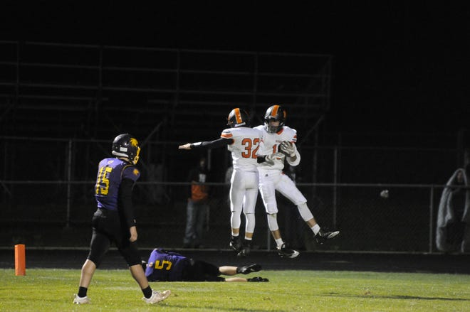 Hudson's Ambrose Horwath (right) and Bronson Marry (left) celebrate a touchdown during a game at Onsted in 2020.