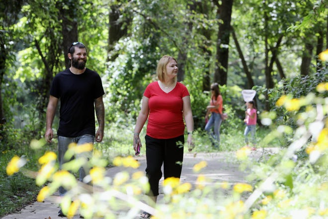 Nick Adrian and Brandi Lee Dyer, both of Wapello, take a walk on some the 3.7 miles of trails at Starr's Cave Nature Center Saturday during the Des Moines County Conservation Summer Celebration at the nature center. Visitors explored Flint Creek for a critter catch, hiked and biked the trails at the nature center along enjoyed lunch provided by Des Moines County Conservation.